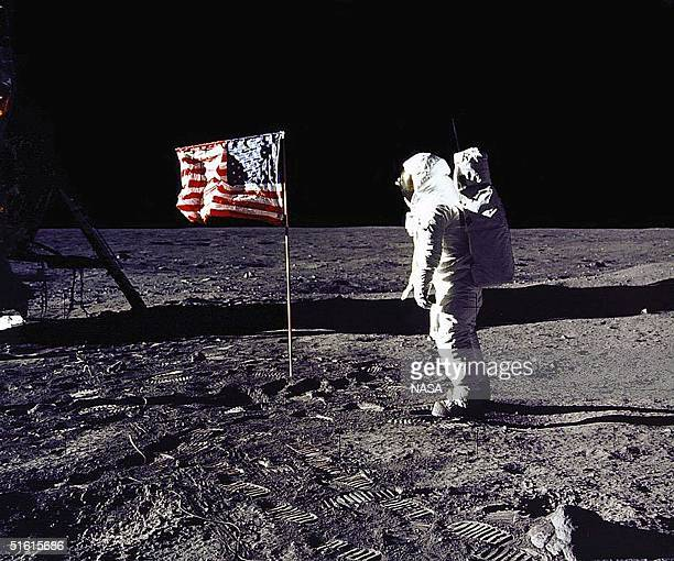 This 20 July 1969 file photo released by NASA shows astronaut Edwin E 'Buzz' Aldrin Jr saluting the US flag on the surface of the Moon during the...