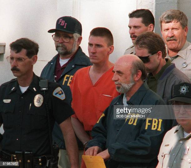 This 21 April 1995 file photo shows Timothy McVeigh being led from the Noble County Courthouse in Perry Oklahoma by FBI agents after being charged...