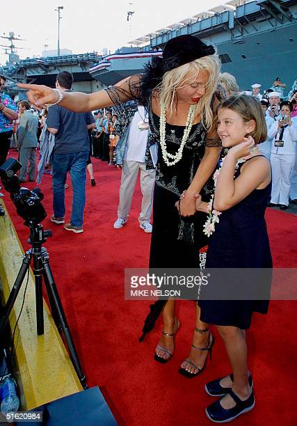 This 21 May 2001 file photo shows US actress/musician Courtney Love pointing to a photographer as she arrives with her daughter Frances for the world...