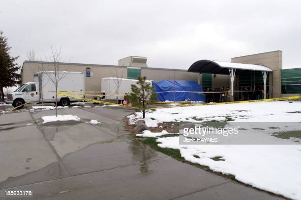 This 22 April side view of Columbine High School in Littleton CO shows the evidence truck outside the site where fourteen students and one teacher...