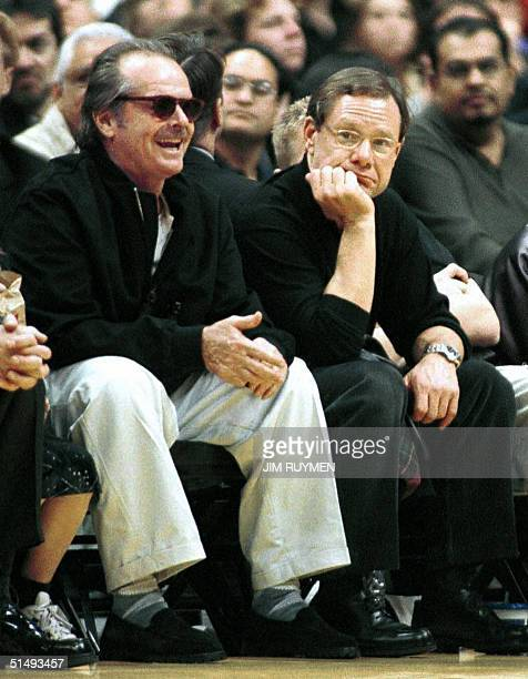 This 22 January 2000 file shows former Hollywood star agent Michael Ovitz and US actor Jack Nicholson watching the Los Angeles Lakers play the...