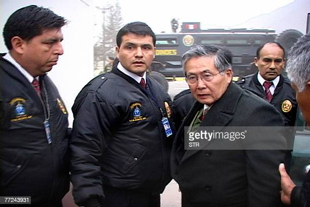 This 22 September 2007 file photo shows former Peruvian president Alberto Fujimori escorted by Interpol officers upon his arrival at the Special...