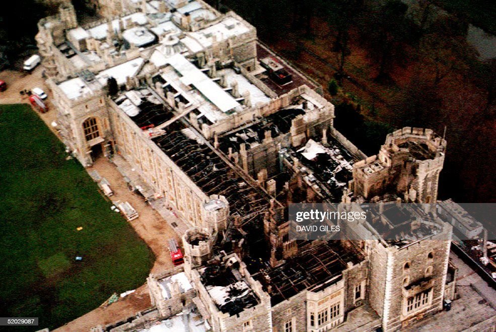 This 23 November aerial view of Windsor Castle in the United Kingdom shows damage to the roof caused by the fire which broke out 20 November. According to Buckingham Palace, very few paintings and other objects of art were destroyed. UK