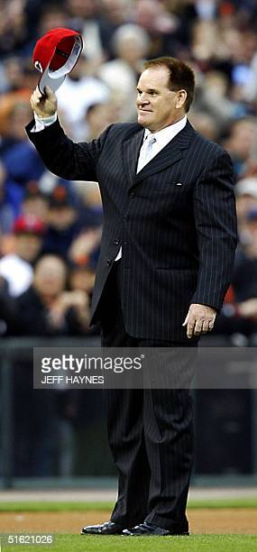 This 23 October 2002 file photo shows alltime hit leader Pete Rose tipping his hat to the crowd before Game Four of the World Series between the...