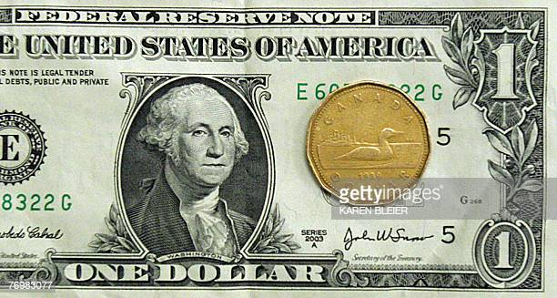 This 24 September 2007 photo shows Canadian dollar and the US dollar Canadians cheered 21 September 2007 for their beloved loonie reaching parity...