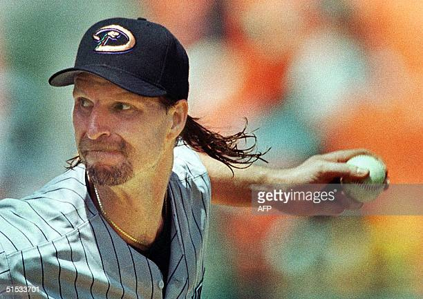This 26 August 1999 file photo shows Arizona Diamondbacks pitcher Randy Johnson winding up to throw a pitch during a game against the Florida Marlins...