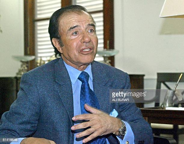 This 26 July file photo shows former Argentine President Carlos Menem in La Rioja Argentina Menem who is campaigning for the elections of 2003 is...