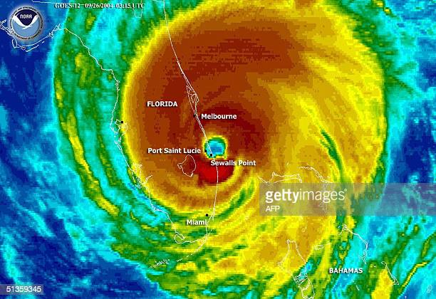 This 26 September 2004 NOAA color enhanced satellite image shows the eye of Hurricane Jeanne moving over the eastern coast of Florida Jeanne battered...