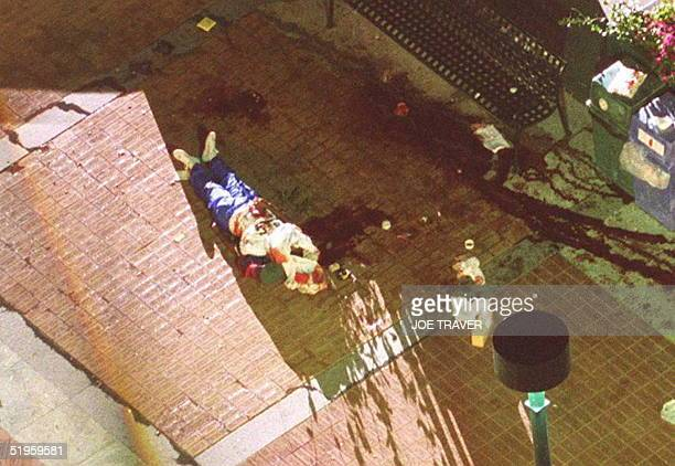 This 27 July 1996 file photo shows one of the fatalities of the bomb blast at Centennial Park in Atlanta lying on the ground The Federal Bureau of...