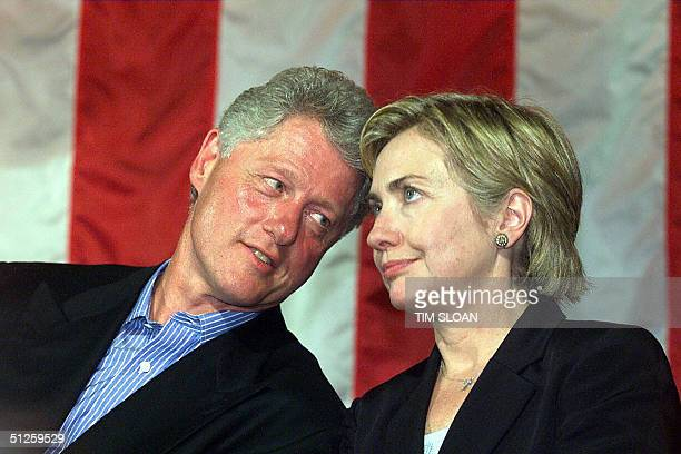 This 28 August file photo shows then US President Bill Clinton and First Lady Hillary Rodham Clinton at the East Hampton Airport in East Hampton New...