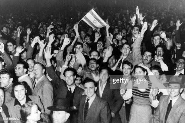 This 29 November 1947 photo taken in Tel Aviv shows residents celebrating the UN deicision to create a Jewish state by dividing Palestine into two...