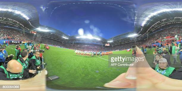 This 360 image shows Germany's and Chile's players posing for the national anthems ahead of the 2017 FIFA Confederations Cup group B football match...