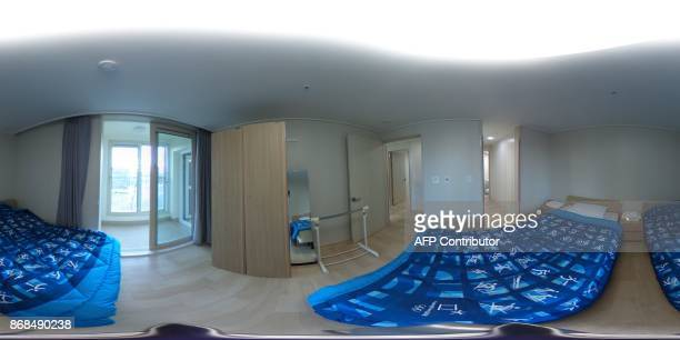 This 360 image taken on October 30 2017 shows a general view of a bedroom inside the athletes village of the Gangneung coastal cluster venues of the...