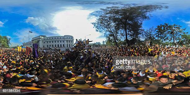 This 360 photo taken in Manila on January 9 2017 shows devotees joining the annual procession with the religious icon of the Black Nazarene Barefoot...