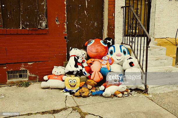 This a a typical youth memorial with stuffed animals found at the sites of murders in urban america.
