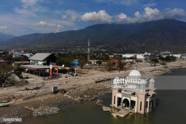 This aerial image shows a damaged mosque in Palu in Indonesia's Central Sulawesi on October 4 after an earthquake and tsunami hit the area on...