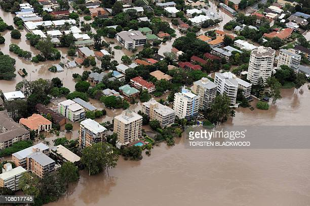 This aerial image shows luxury apartment blocks rising out of the murky waters of the Brisbane River as flood waters devastate much of Brisbane on...