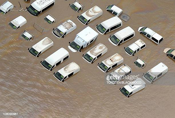 This aerial image shows submerged cars for sale as flood waters devastate much of Brisbane on January 13 2011 Australia's thirdlargest city Brisbane...