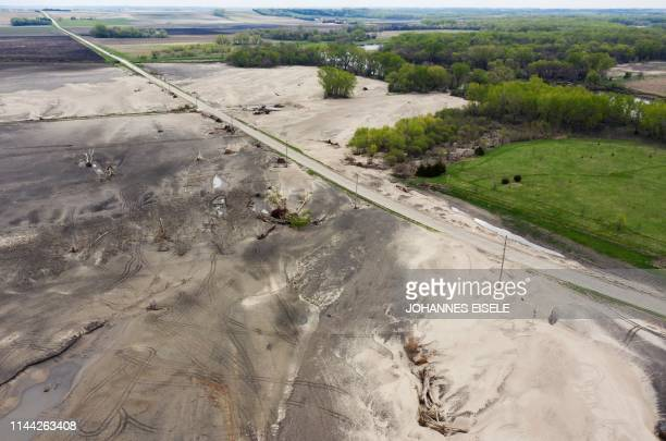 This aerial image shows uprooted trees lie on a field destroyed by the flooding of the Elkhorn River in March near Scribner Nebraska on May 5 2019