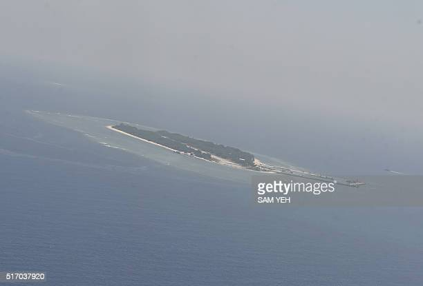 This aerial image taken from a C130 transport plane shows a general view of Taiping island during a visit by journalists to the island in the...