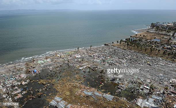 This aerial photo shows a devastated area in the city of Tacloban, Leyte province, in the central Philippines on November 11 only days after Super...