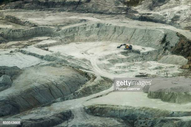 This aerial photo shows an excavator in the middle of a gravel pit on August 04 2017 in Kamenz Germany