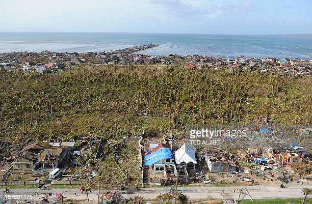 This aerial photo shows destroyed and badly damaged houses well inland from the coast in the town of Guiuan in Eastern Samar province central...