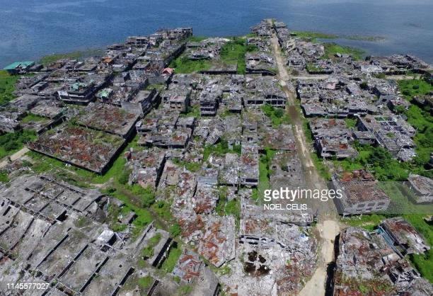 TOPSHOT This aerial photo shows destroyed buildings in Marawi on the southern island of Mindanao May 23 2019 Two years after the Philippine city of...