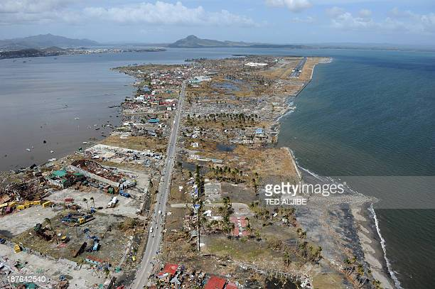 This aerial photo shows destroyed houses and the airport terminal in the city of Tacloban Leyte province in the central Philippines on November 11...