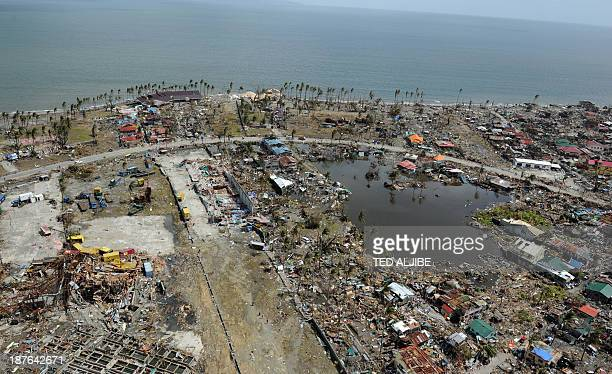 This aerial photo shows destroyed houses in the city of Tacloban Leyte province in the central Philippines on November 11 only days after Super...