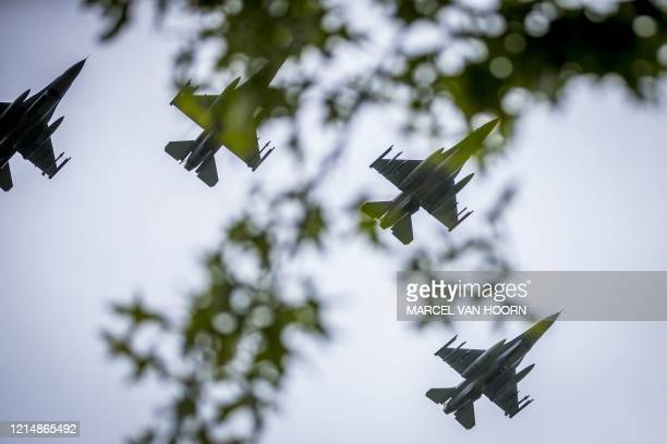 This aerial photo shows F16s jets of the Royal Netherlands Air Force in the missingman formation during the Memorial Day ceremony at the Margraten...