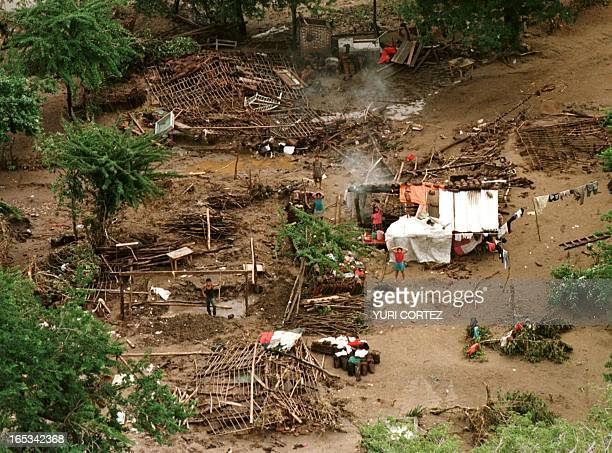 This aerial photo shows part of the town Pespire Honduras 04 November as a few survivors try to put their homes back together a few days after...