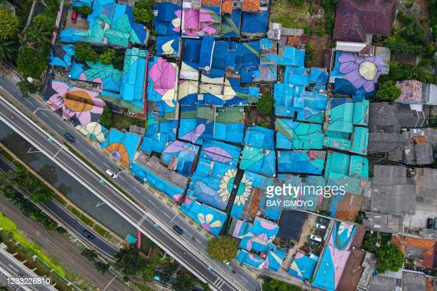 This aerial photo shows residents' homes painted by the local government in Jakarta on June 2, 2021.