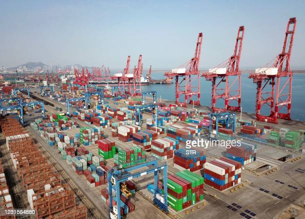 This aerial photo shows shipping containers for export stacked at a port in Lianyungang, in China's eastern Jiangsu province on March 7 as the...