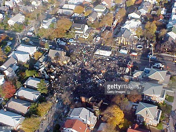 This aerial photo shows the crash site of American Airlines flight 587 November 16 2001 in Queens New York The Airbus A300 passenger jet bound for...