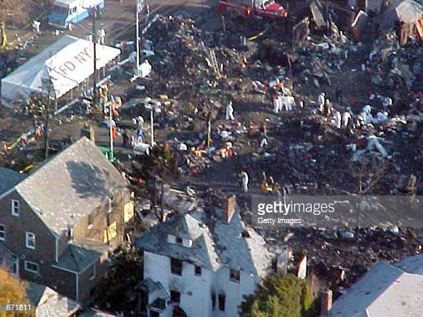 This aerial photo shows the crash site of American Airlines flight 587, November 16, 2001 in Queens, New York. The Airbus A-300 passenger jet, bound...