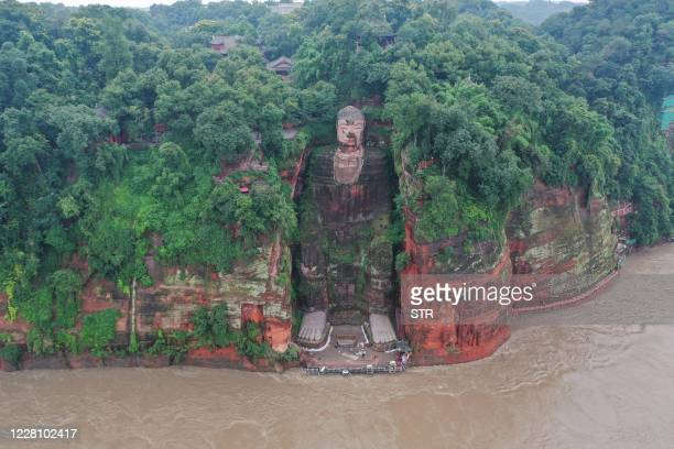 This aerial photo shows the Leshan Giant Buddha surrounded by floodwaters following heavy rains in Leshan in China's southwestern Sichuan province on...