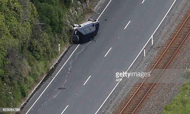 This aerial photo taken and received on November 14 2016 shows a car on its side near Kaikoura following an earthquake on the South Island's east...
