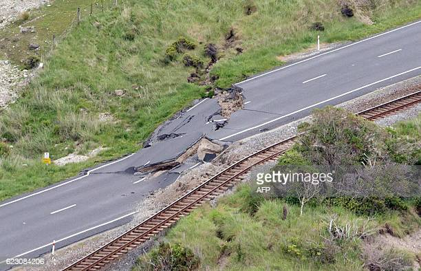 TOPSHOT This aerial photo taken and received on November 14 2016 shows earthquake damage to State Highway One near Ohau Point on the South Island's...