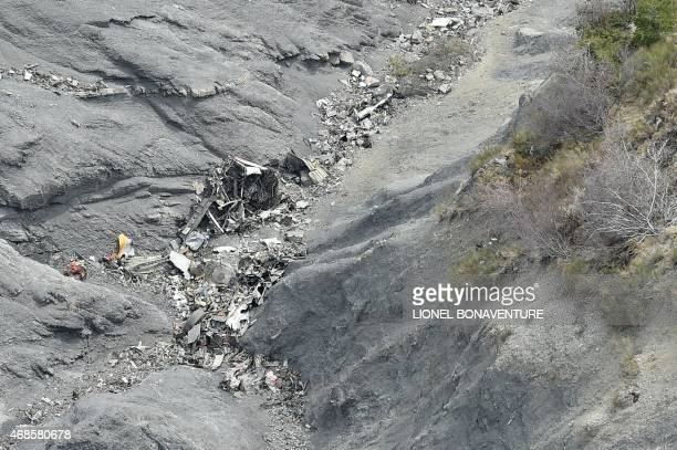 This aerial photo taken from a helicopter on April 3 2015 shows a closeup view of scattered debris at the crash site of the Germanwings Airbus A320...