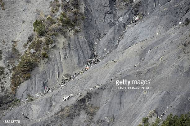 This aerial photo taken from a helicopter on April 3 2015 shows debris at the crash site of the Germanwings Airbus A320 near the small village of Le...