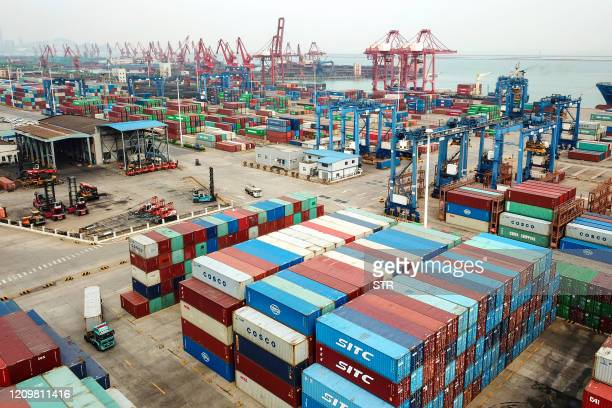 This aerial photo taken on April 14, 2020 shows containers stacked at a port in Lianyungang in China's eastern Jiangsu province. - China's foreign...