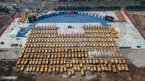 This aerial photo taken on April 16, 2020 shows trucks gathered at the ground-breaking ceremony of Guangzhou Evergrande's new stadium in Guangzhou in...