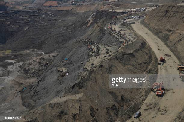 This aerial photo taken on April 23 2019 shows search and rescue personnel looking for miners at a jade mine following a landslide in Hpakant Kachin...