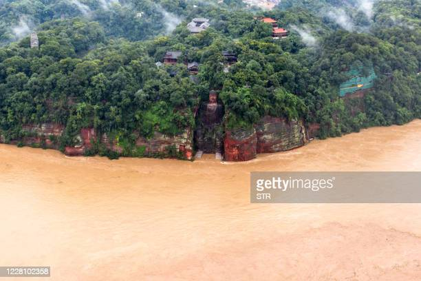 This aerial photo taken on August 18, 2020 shows the Leshan Giant Buddha surrounded by floodwaters following heavy rains in Leshan in China's...