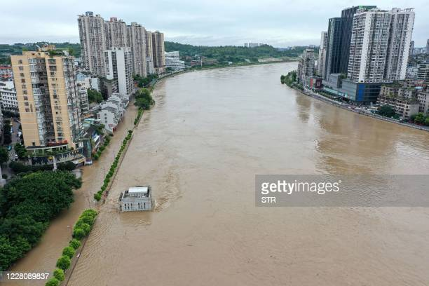 This aerial photo taken on August 18, 2020 shows the swollen Tuojiang River following heavy rain in Neijiang in China's southwestern Sichuan...