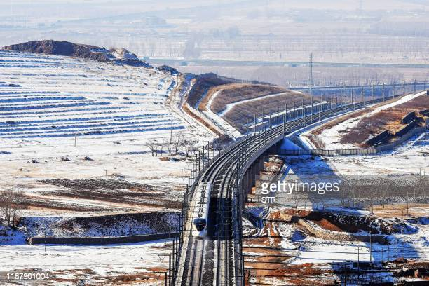 This aerial photo taken on December 9, 2019 shows a bullet train undergoing a test run between Beijing and Hohhot in China's northern Inner Mongolia...