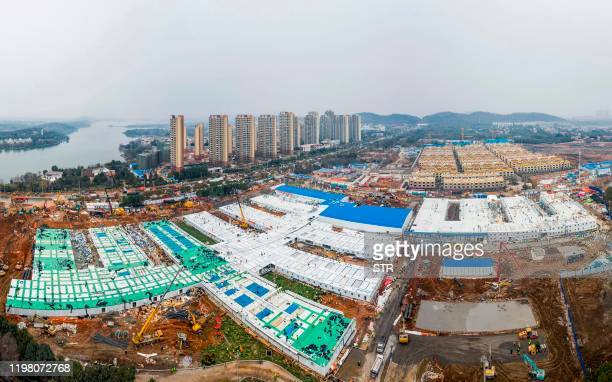 TOPSHOT This aerial photo taken on February 2 2020 shows the Huoshenshan hospital which means Fire God Mountain after handed over to China's army in...