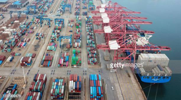 This aerial photo taken on July 14, 2020 shows containers stacked at a port in Lianyungang in China's eastern Jiangsu province. - Chinese trade...