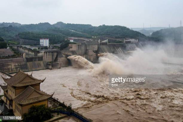 This aerial photo taken on July 19, 2020 shows water released from the Xiaolangdi Reservoir Dam in Luoyang in China's central Henan province, in...